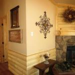 Log interior accents - log wainscot and log above fireplace available to see at Recreational Resort Cottages in Rockwall, Texas