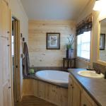 Southern Yellow Pine Accent Wall Over the Tub available through Recreational Resort Cottages and Cabins in Rockwall, Texas