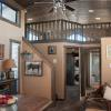 The Meadowview P-528FPSPSL wrap around porch model by Platinum Cottages & RRC Athens. See above for the floorplan, pictures, pricing and a virtual tour of this model currently on display in Athens TX.