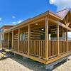 The Meadowview P-528FPSPSL wrap around porch model by Platinum Cottages & RRC Athens. See above for the floorplan, pictures, pricing and a virtual tour of this model currently on display in Athens TX