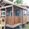 The Austin model by Platinum Cottages on display @ RRC Athens. This Tiny House Jamboree show model features a unique exterior, double porches, tall ceilings throughout with cedar beams & more!