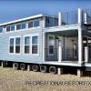 The Whitman 106 Elite model By Platinum Cottages. Shown here with an optional double decker porch and double loft. This model is exclusive to Recreational Resort Cottages.