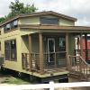 The Tumbleweed model P-576 by Platinum Cottages on display @ RRC Athens. This 15' wide park model features a shed style front porch roof, a huge loft and a king sized downstairs bedroom.